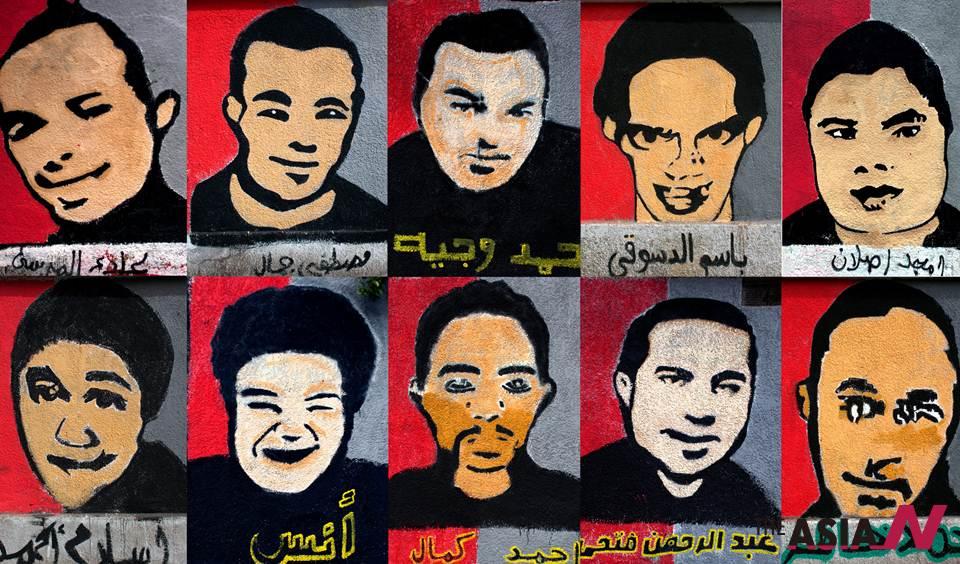 الألتراس يرسمون جرافيتي شهداء مجزرة بورسعيد على جدران النادي الأهلي